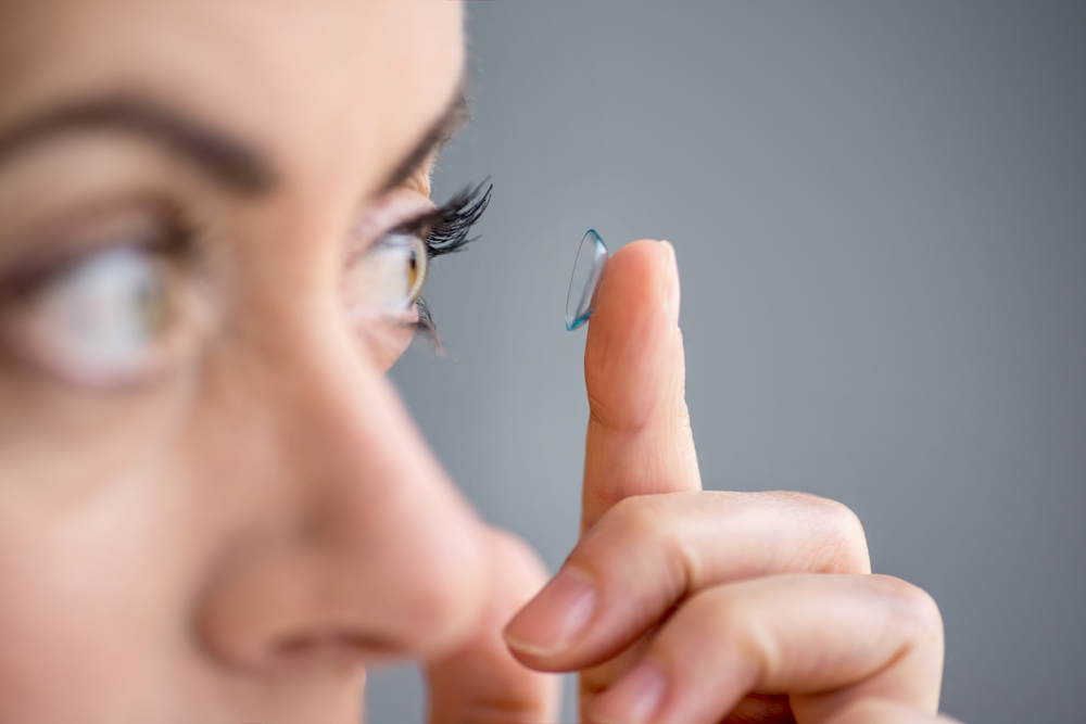 Woman happy to try out her new pair of contact lenses.